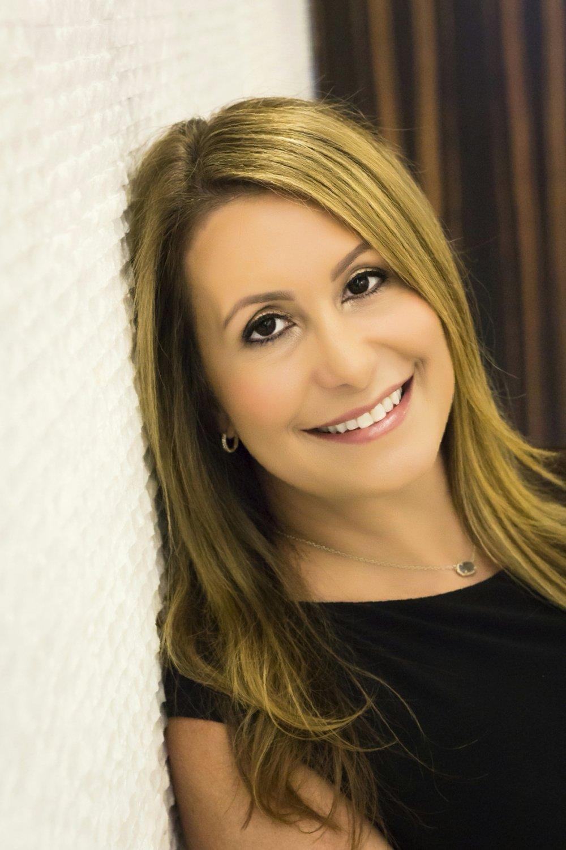 """<b>Stephanie Elovitz</b><br>Executive Director<br><a href=""""mailto:selovitz@okonhannagan.com"""">Email Me</a><br>214.396.9653"""