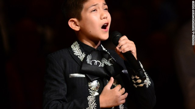 By Cindy Y. Rodriguez     Mexican-American boy's national anthem sparks racist comments    An 11-year-old boy's rendition of the national anthem at Game 3 of the NBA finals brought the usual appreciative applause Tuesday, but outside AT&T Center in San Antonio, his performance brought a darker reaction from some posters on social media -- and eventually an online backlash against their racist comments.  Here's a sampling of some of the unkind tweets that went flying around the Internet about Sebastien de la Cruz: