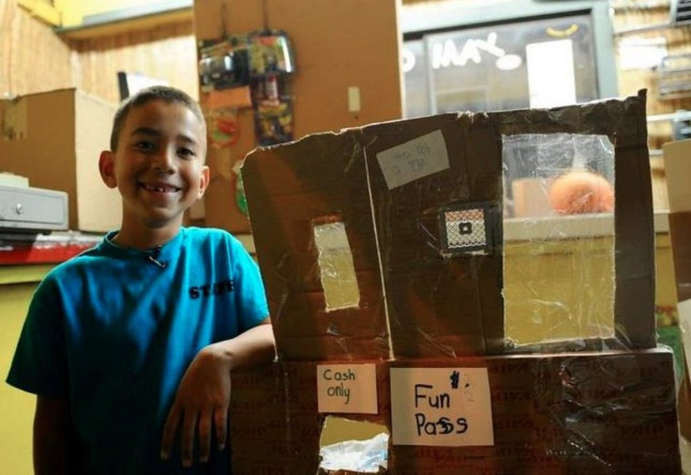 "By Cindy Y. Rodriguez 9-Year-Old Boy Builds His Own Cardboard Arcade Meet Caine Monroy. He is nine years old and he spent his summer break last year meticulously building a makeshift arcade—appropriately named ""Caine's Arcade""— made out of cardboard boxes in his dad's auto part store. Smart Parts Aftermarket is located in an industrial part of East Los Angeles, and is predominantly a Hispanic neighborhood, according to the Census. The auto store doesn't get much foot traffic; in fact, Caine never had a customer until filmmaker Nirvan Mullick showed up."