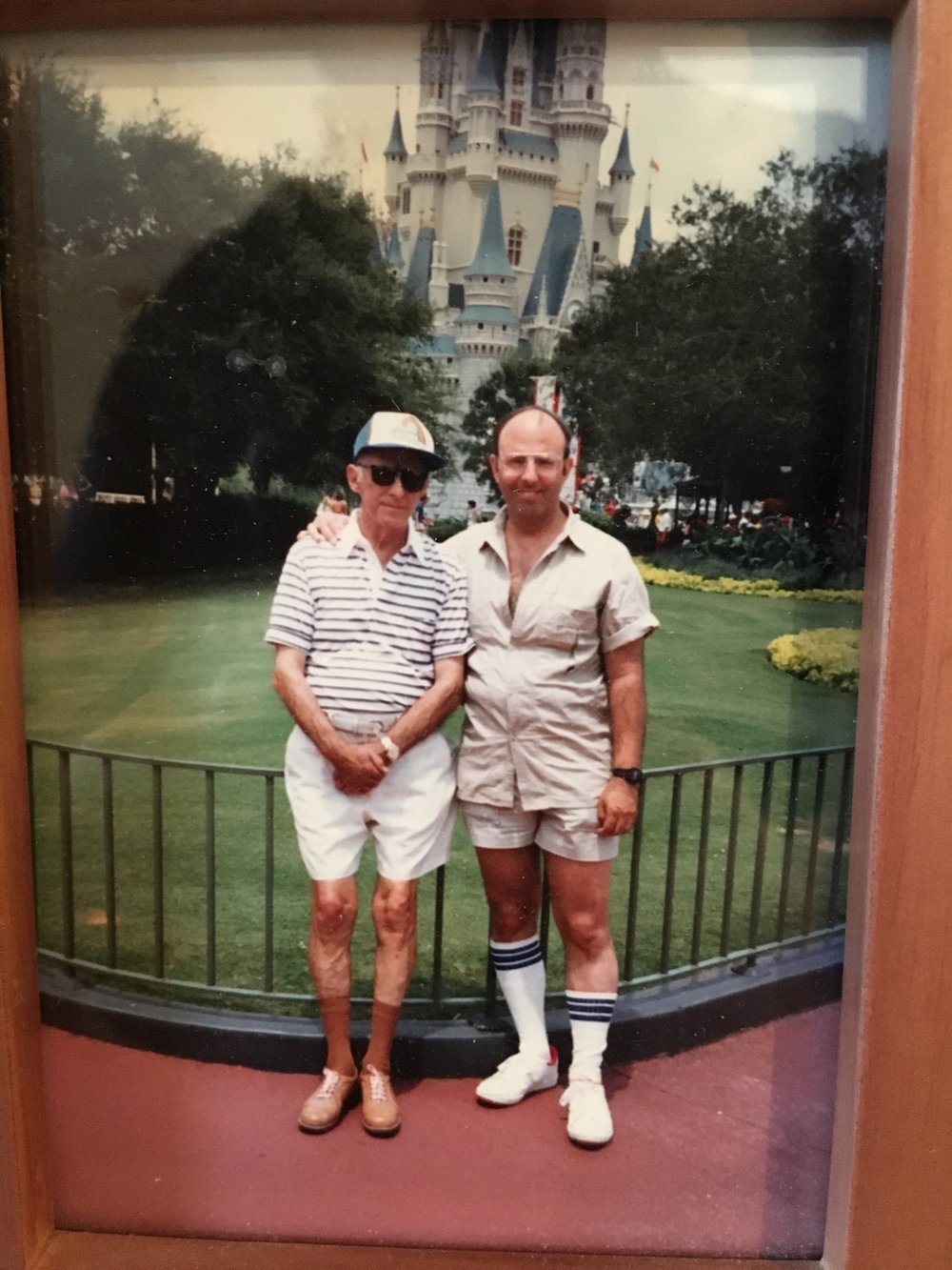 Grandpop and Pop in Disney World (and their knee socks!)