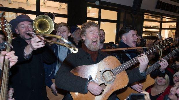 Glen Hansard of The Frames busking on Grafton Street on Christmas Eve.Photograph: Dave Meehan