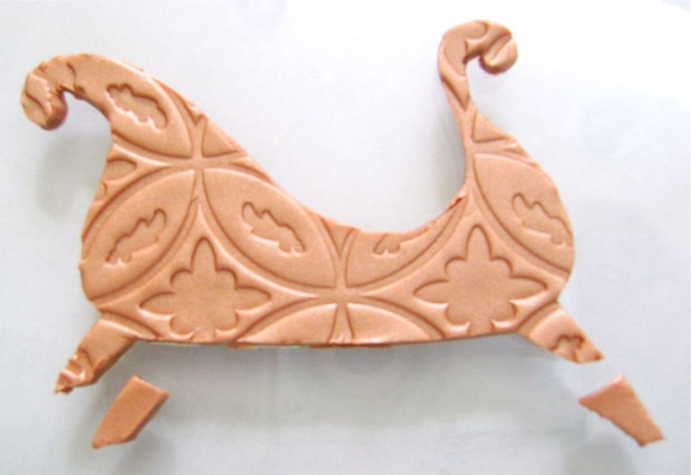 step 4 - Cut out two additional sleigh legs from the extra copper clay.  Set these pieces aside.
