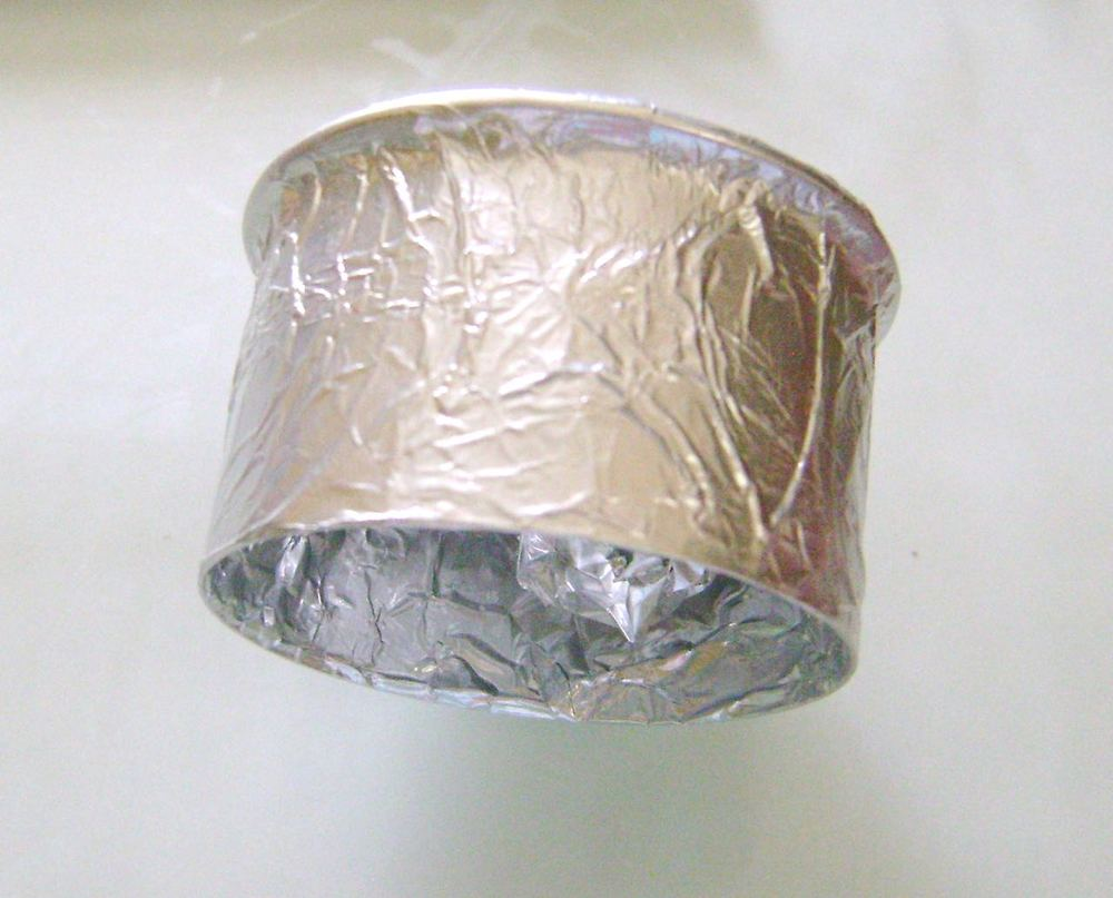 "step 6 - Wrap a 2"" round cookie cutter as smoothly as possible with aluminum foil.  Tuck the edges inside."