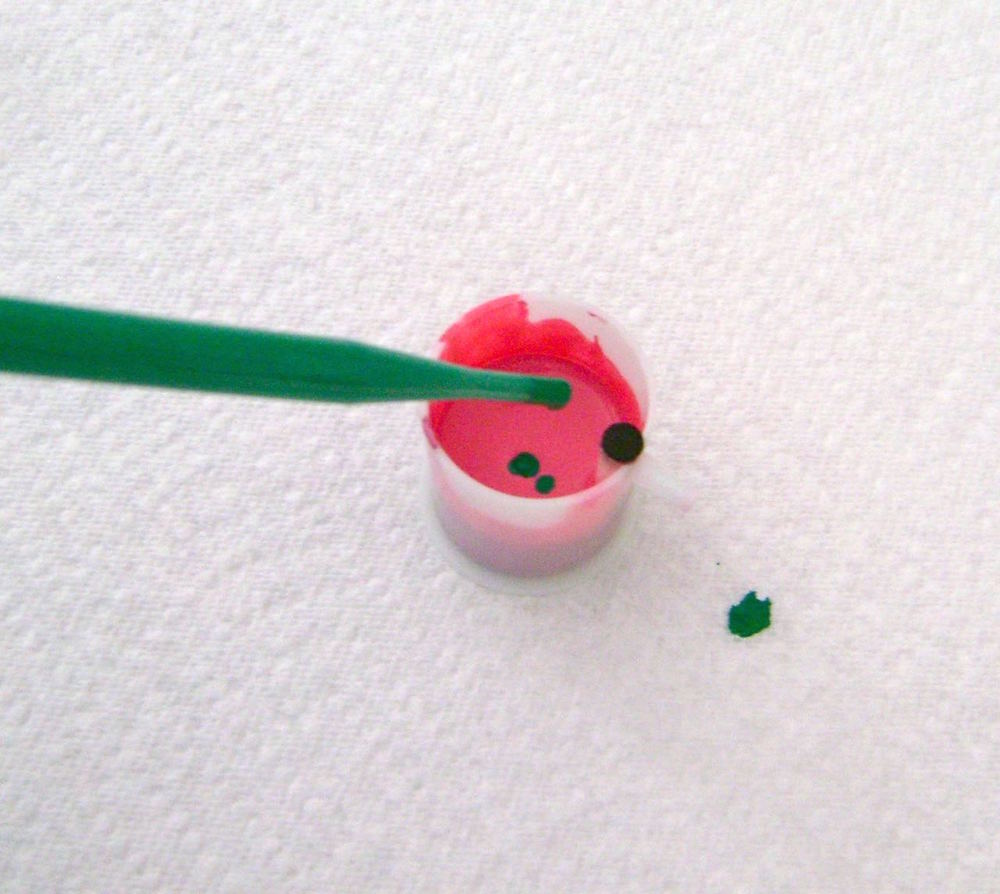 step 9 - Mute the tones of the pink and green paint, with a pipette (paint eye dropper) by adding a few drops of green to the pink, and a few drops pink to the green.  Add red to either of the blended colors to create the pale mauve color.