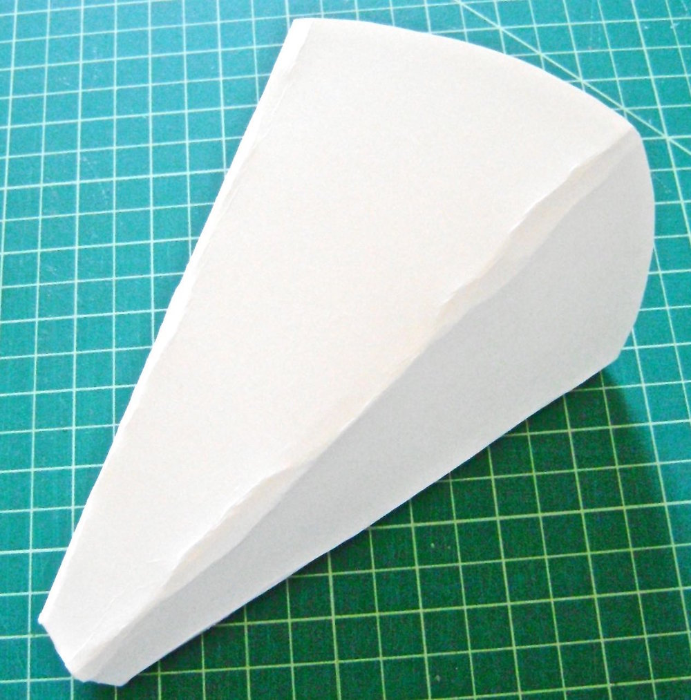 step 4 - Press the mold cone sides flat with the center front and center back aligned, but do not crease the sides.  The finished sconce should not be a round cone shape like a party hat but more a party hat that has been flattened a bit.