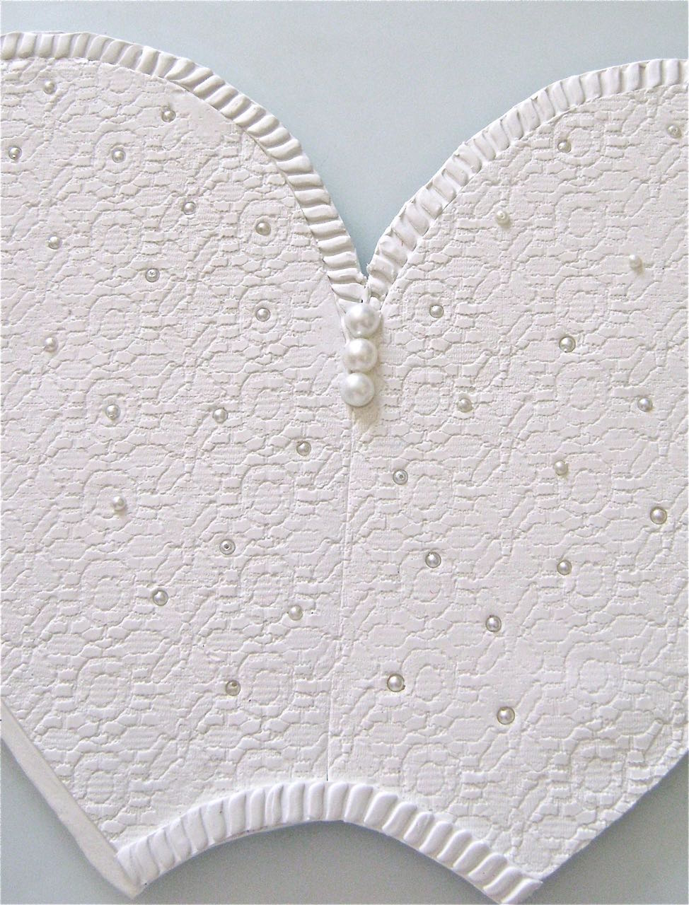 step 13 - Arrange seed pearls randomly on the front embossed areas.  When you're certain of placement, push down on the beads with the flat wide edge of a ruler to evenly embed them into the clay.