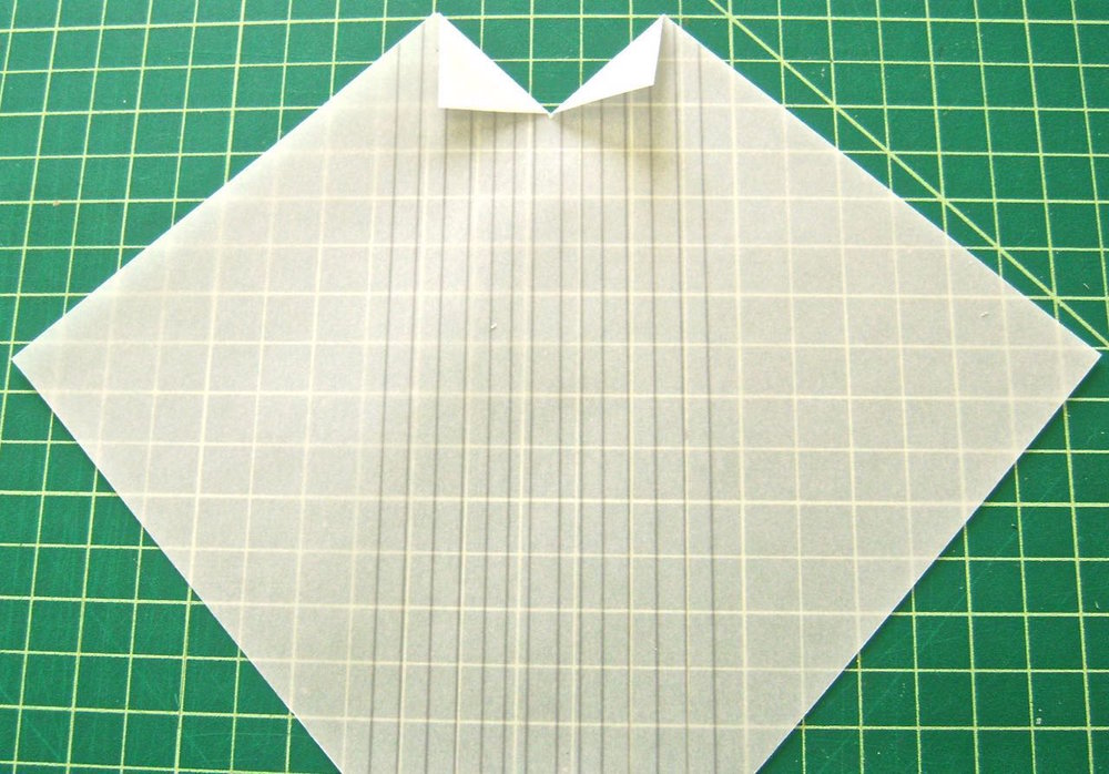 step 3 - Create the tux shirt collar by making a 1' slit in the vertical center of the shirt.  Fold the slit pieces into triangles.