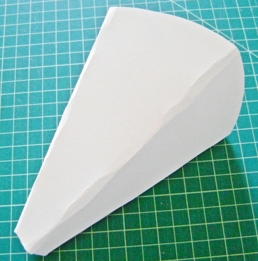 step 6 - The finished sconce should not be a round cone shape like a party hat but more a party hat that has been flattened a bit. To achieve the shape, press the mold sides flat with the center front and center back aligned, but do not crease the sides.