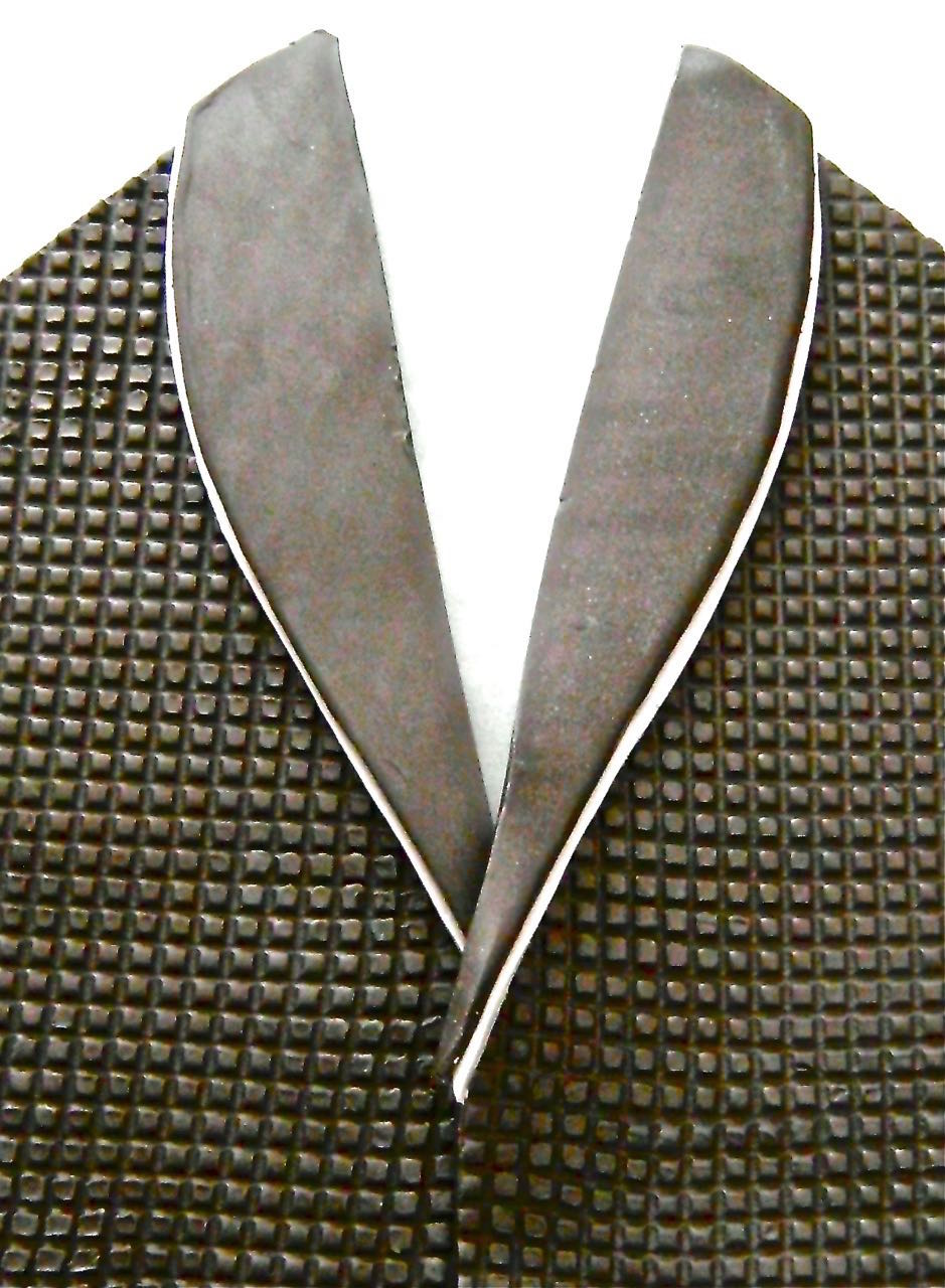 "step 9 - Place the black lapel piece on top of the silver, allowing the silver to stick out and form a thin decorative edge.  Align the lapels on top of the sconce pieces.  Overlap the center fronts about 1/8"".  Cut away the bottom left lapel where it meets the right to eliminate excess bulk of the combined pieces.  Also press the length of the left center edge with a craft stick to thin it.  Press to join the left and right pieces."