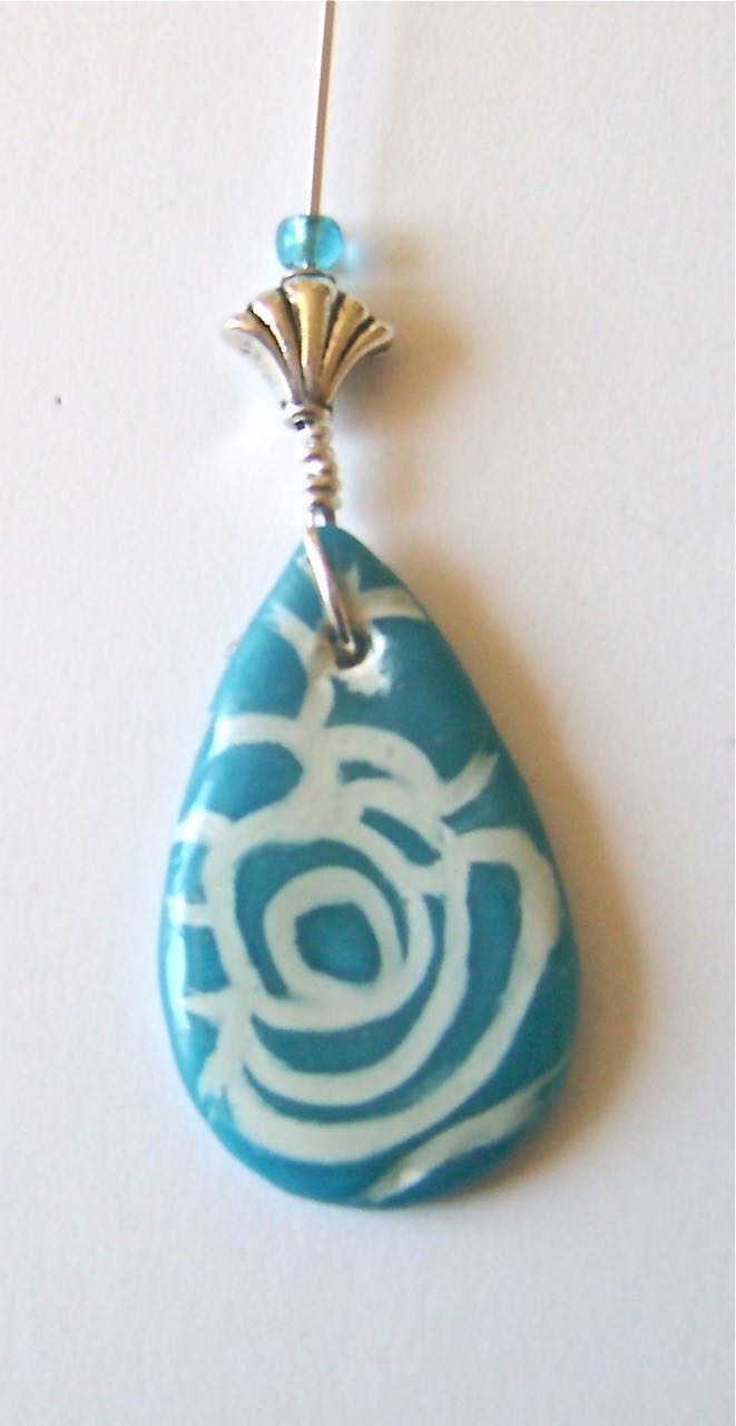 step 13 - Bend the long wire upward.  Slip the silver decorative bead and turquoise bead over both wires.