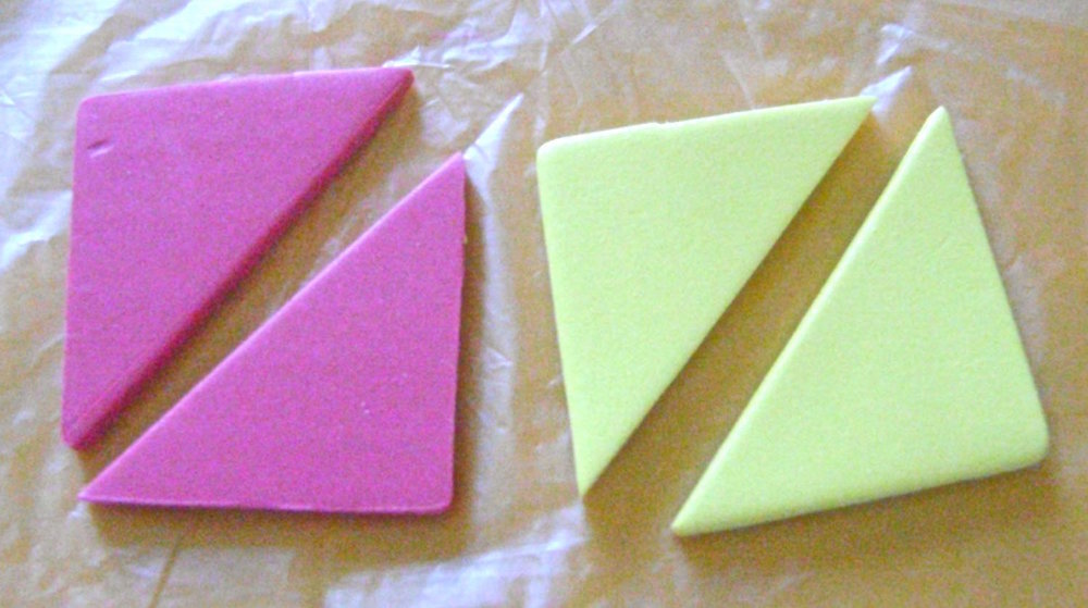 """step 1 - Roll the pink and yellow clay with the conditioning machine set on #1. Use a blade to cut a 3"""" square from each piece. Then cut each diagonally. (Due to lighting problems in my work room, not all of the clay colors in the step photos are represented with accuracy.)"""