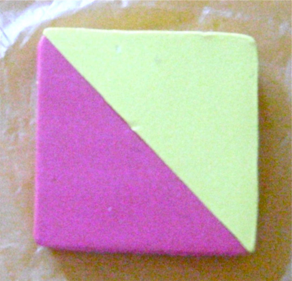 step 2 - Stack the two pink triangles with all edges aligned.  Do the same with the yellow.  Press them together to attach them at the diagonal seam.