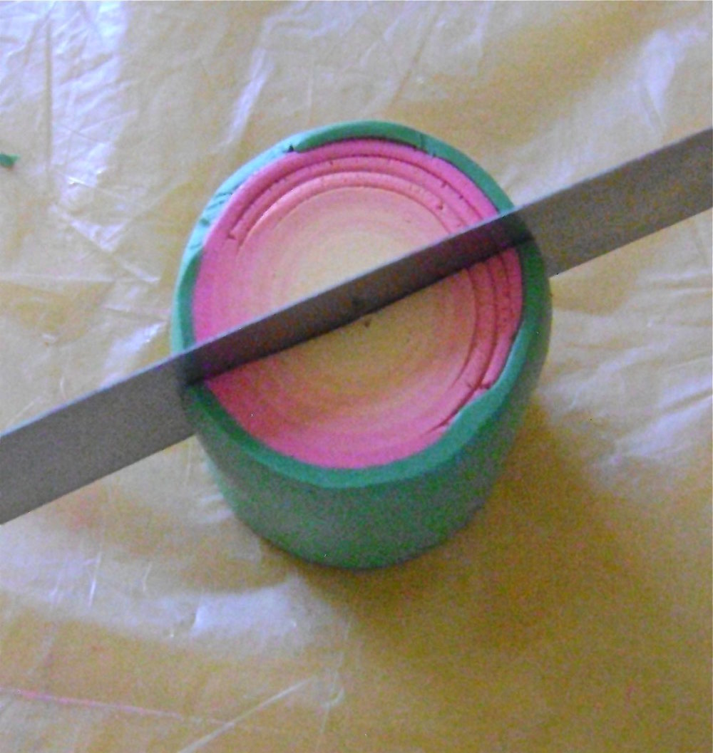 step 9 - Slice down through the jellyroll creating two halves.  Arrange them with round edges touching.