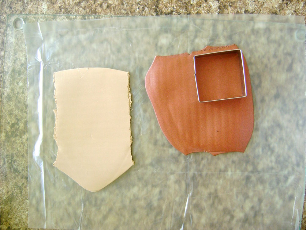 "step 2 - You will need approximately two ounces of Bronze, one ounce of Tan and four ounces of White Translucent clay.  Pass Bronze and Tan pieces through the conditioning machine on the# 1 setting.  With a 1.50"" cutter, create four squares of each."