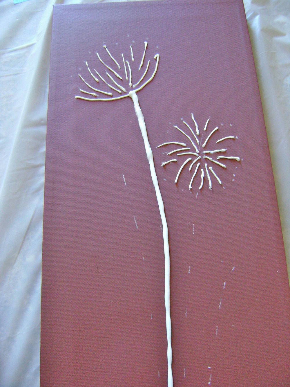 step 10 - Create the two thick flower stems with the caulking.