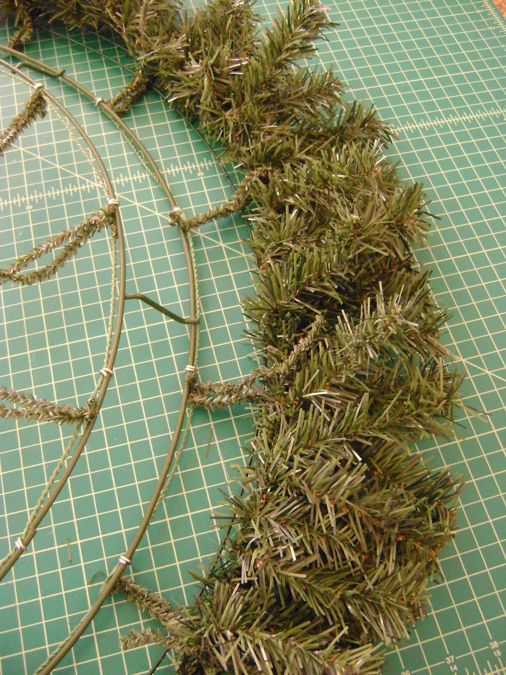 step 5 - As you attach the garland, bend all the stems to the outside which will give the wreath a larger diameter.