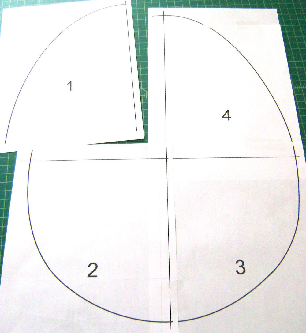 "step 1 -  Draw a 20"" long egg shape on foam board.  If you don't trust your drawing ability, find an egg image online and enlarge it to 20"" in a drawing program or Photoshop.  Print it out in four pieces and tape them together.  Use the printout to cut the foam board with a craft knife."