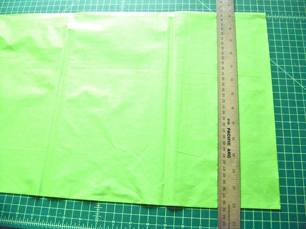 "step 3 - Remove the table cloth from the package and unfold it lengthwise.  Do not open the width, leave it folded so you can cut several strips at once.  Cut 3.50"" wide strips across the length.  You will need three of the green, yellow, and pink.  Cut 21 to 24 of the white.  How tightly you gather the strips will determine how many you will need.  The individual strips will each measure3.5"" x 54""."