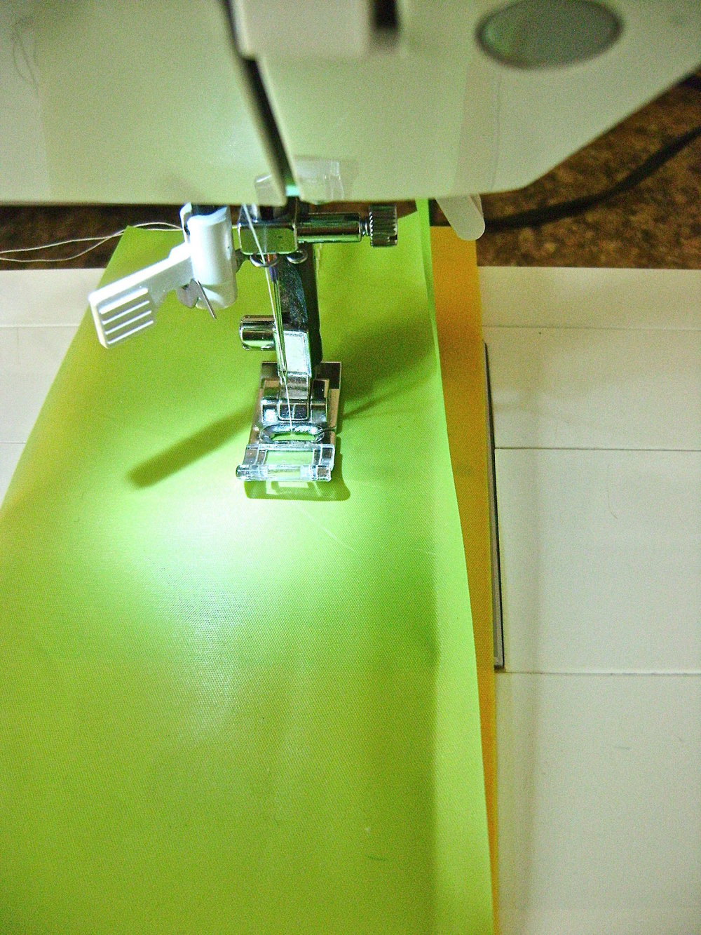 "step 4 - Create a ""set"" by stacking a green, yellow and pink layer with edges aligned.  Sew down the length 1.50"" from the edge.  Sew another line of stitching .50"" from the first to create a casing.  Sew two more color sets.  Sew the white sets by stacking 3 white layers in each set."