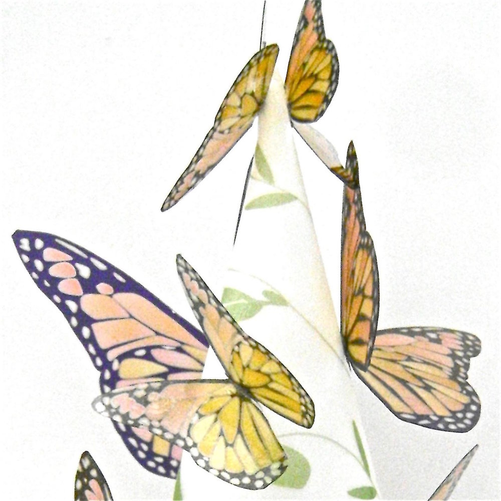 step 9 - Apply hot glue to the crease on each butterfly and randomly attach the butterflies to the shade alternating sizes.
