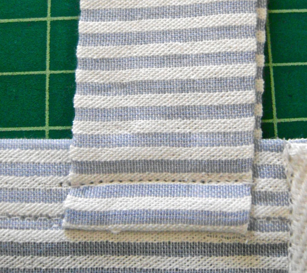 "step 16 - Turn the straps up and topstitch 3/8"" from the first row of stitching."
