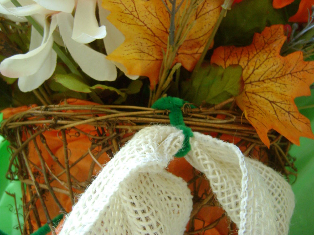 "step 7 - Attach the pipe cleaners to the basket edge evenly distributing them, about 1.50"" between each. Once you're happy with the placement, tuck the wire ends inside the basket.  Fluff up the burlap to cover the wires."