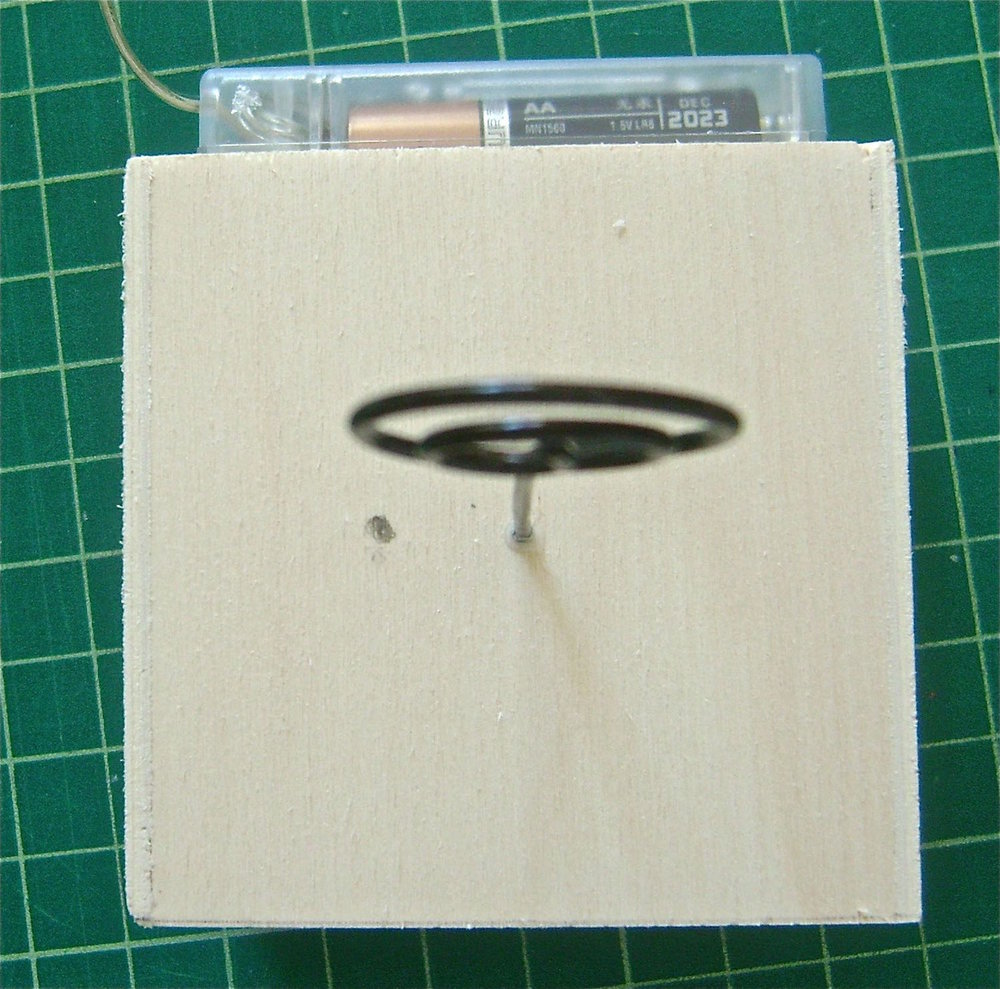 "step 2 -Make another mark about .50"" to the left of the wire photo holder in the top of the cube.  Drill holes in the two marks large enough to pass the light string through."