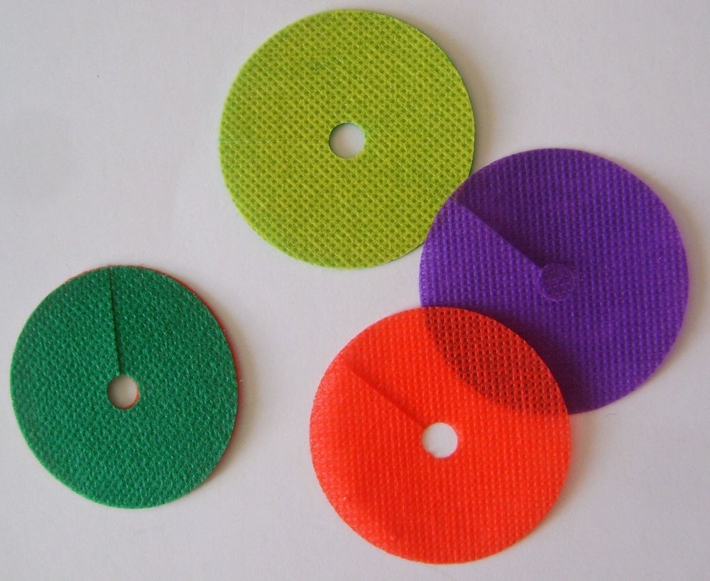 "step 10 - Cut 14 discs measuring 2"" round in a variety of colors.  Cut a hole in the center of each and a slit from the outside edge to the hole.  Use the glue stick to attach together two different colors until you have seven discs."