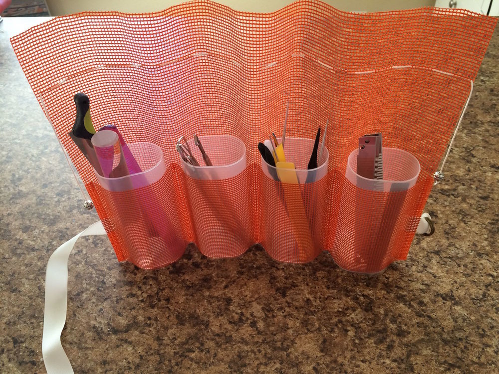 step 7 - Place the containers into the cuffs and fill them with your tools.  If your tools aren't tall enough to stick out of the top of the container, use the lid as a pattern and cut foam a little smaller than the pattern.  Place it in the bottom of the container then fill it with your tools.