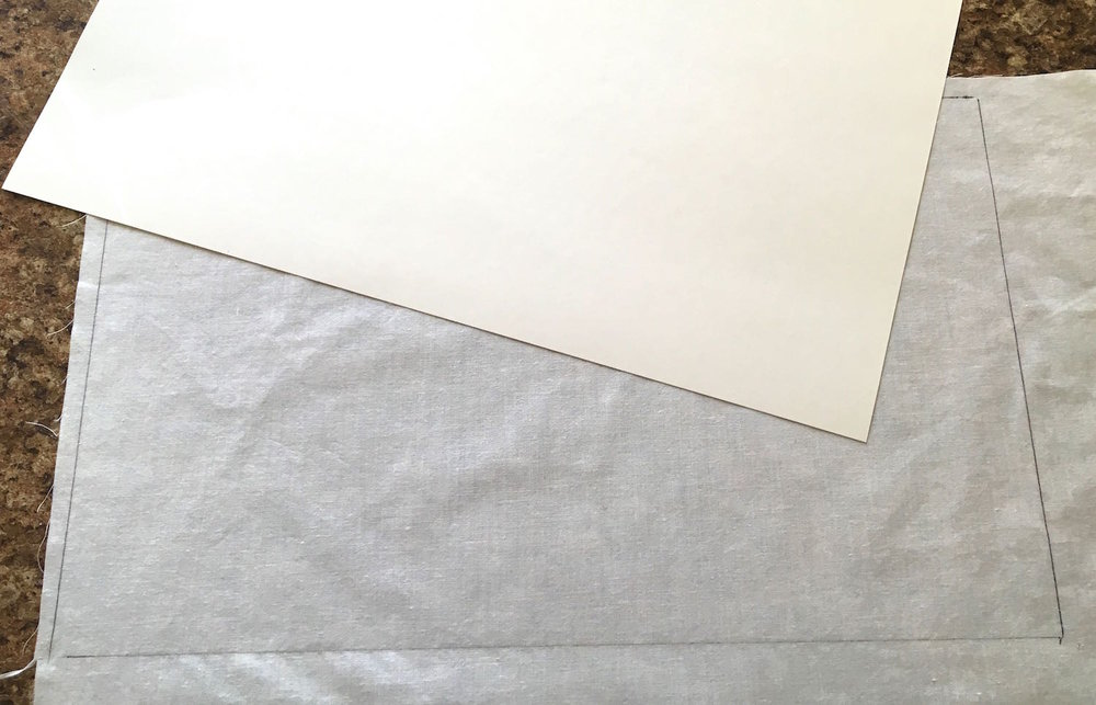 "step 1 - With a pen, trace a 8.50"" x 14"" sheet of card stock onto white cotton."