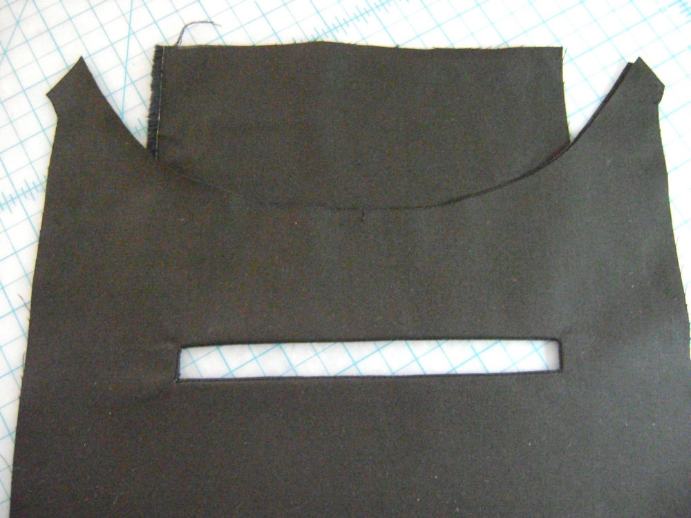 step 3 - Pull the pocket through the slit to the wrong side and smooth the opening.