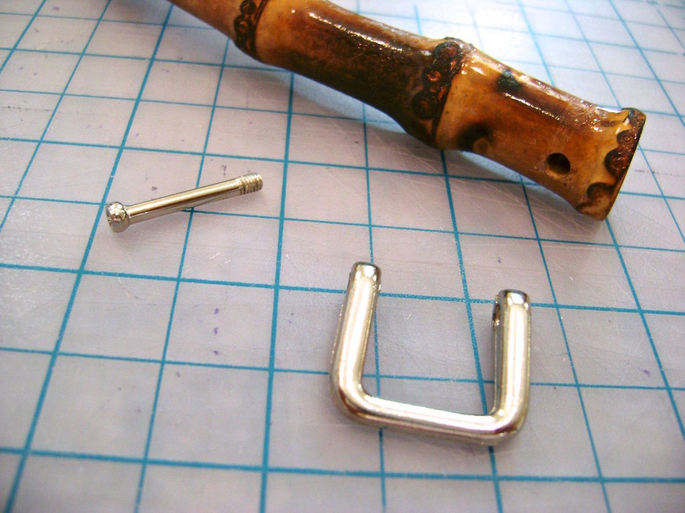 "step 10 - Remove the screws in the bamboo handles and thread the metal ""U"" into the purse loops."