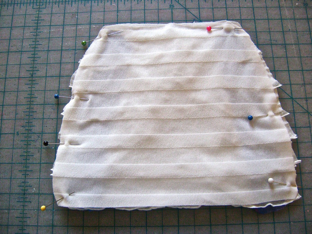 "step 2 - Turn the ruffle fabric right sides together and sew the side seams from the bottom to the side opening notches.  Allow a scant 1/4"" seam."
