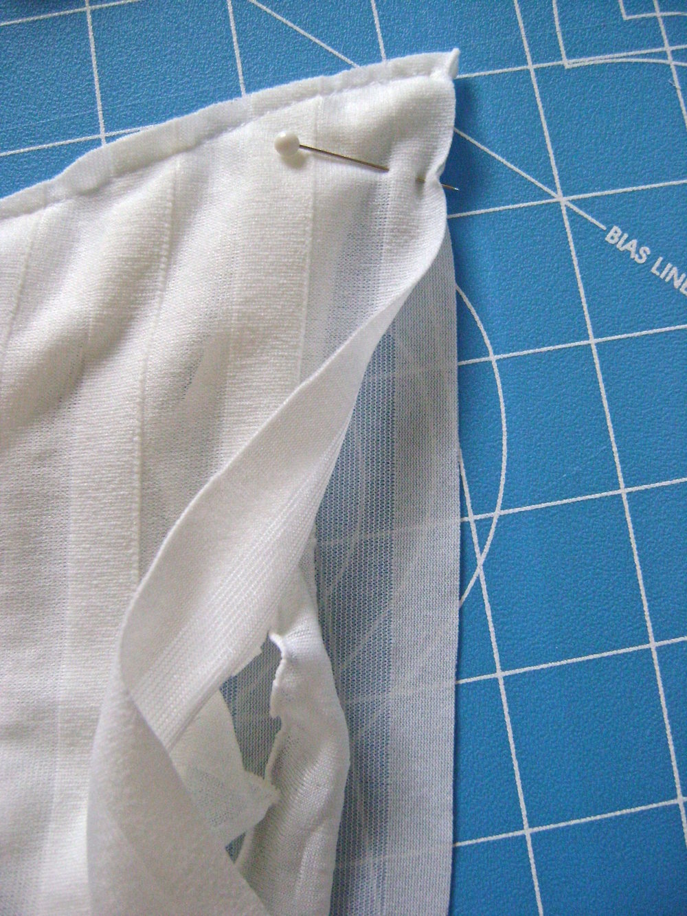 step 3 - Sew the bottom seam by moving aside the ruffles and joining the front and back with as small a seam as possible.