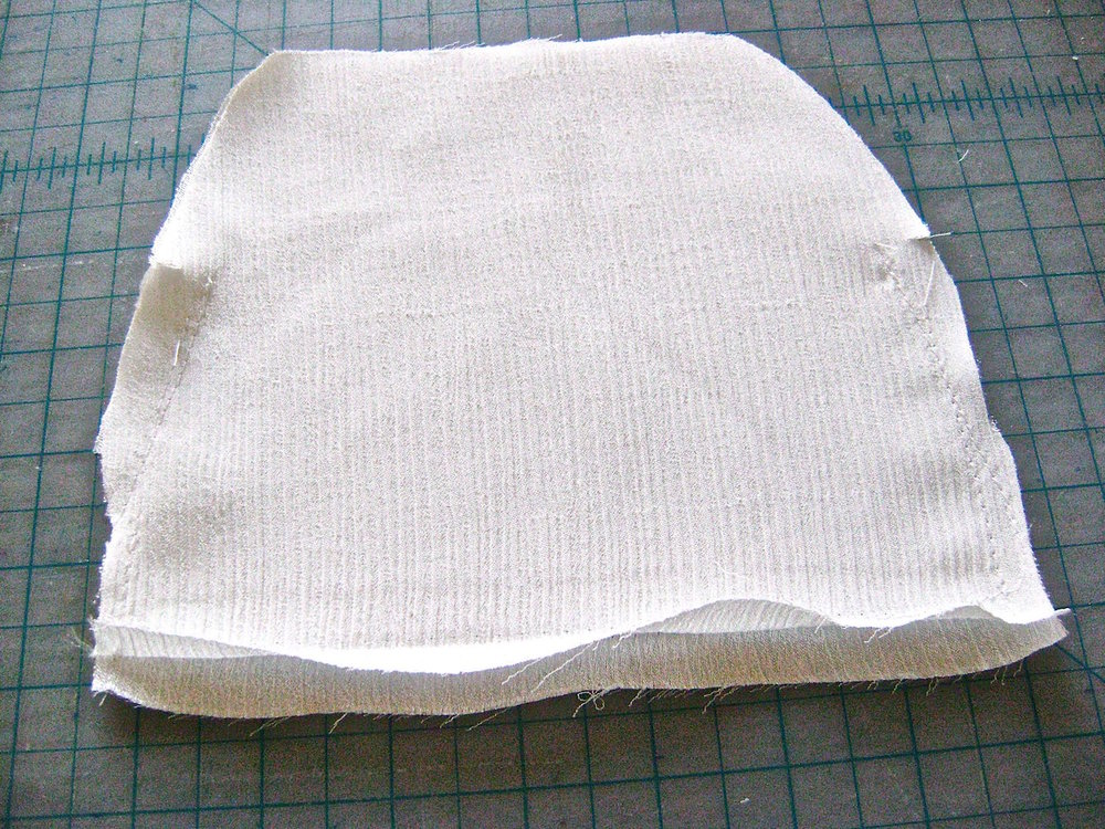 "step 5 - Sew the center 5"" of the lining bottom seam with a basting stitch.  Press the seam open.  With a normal stitch, sew the bottom seam 1"" in from both corners.  Sew the side seams with 1/4"" allowance from the bottom to the side opening notches.  Remove the bottom basting stitch and set the lining aside.  If you will be attaching a personal label to the lining, this is a good time to do it."