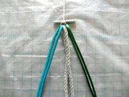 step 3 - Anchor the end to a work surface to hold cords in place while you braid.