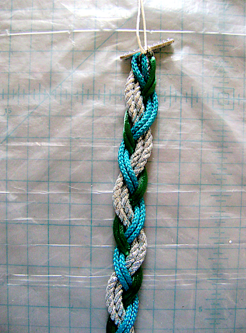 step 4 - Braid holding two cords of the same color.
