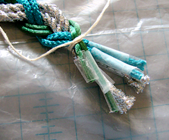 step 6 - Group the ends together temporarily with string.