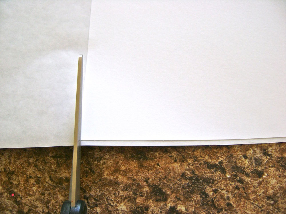"step 7 - Draw a line down the center of a 8.5"" x 11"" page. Spray the opposite side with adhesive. Place the page on the dull side of the Freezer Paper and cut the Freezer Paper to match the same dimensions."