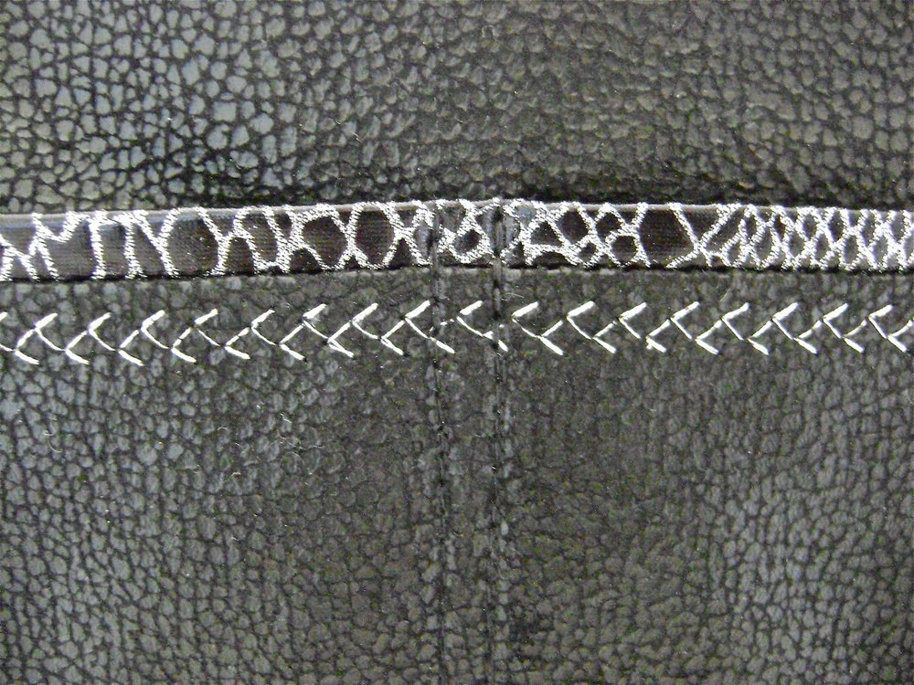 step 11 - Baste the pocket to the purse front.  Double stitch vertically from the pocket top to bottom in the center of the purse.  Divide the spaces to the left and right equally and double stitch again, resulting in four individual pockets.