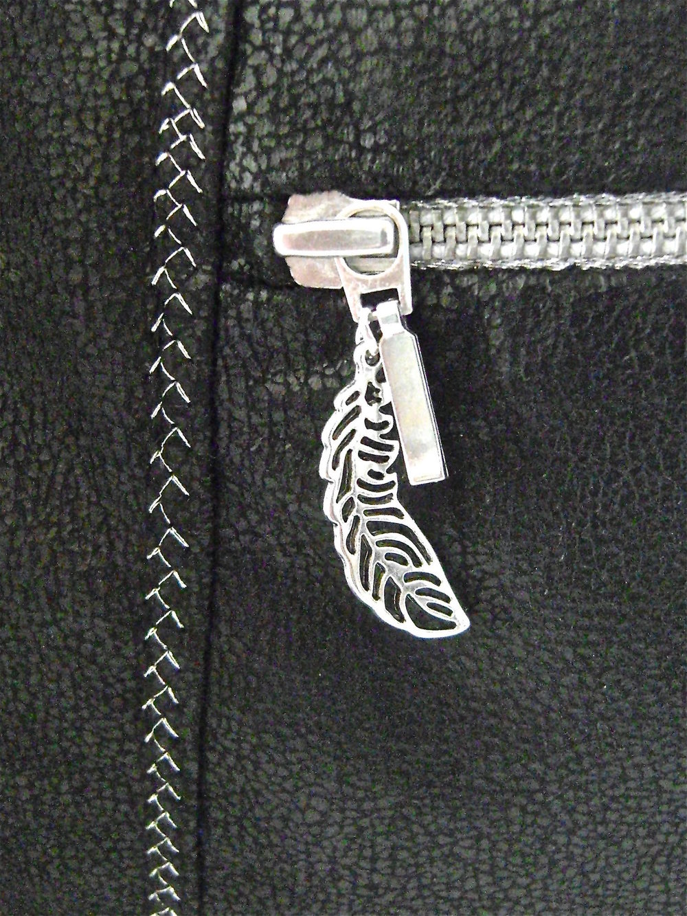 step 40 - Attach a special silver leaf charm to the zipper pull.