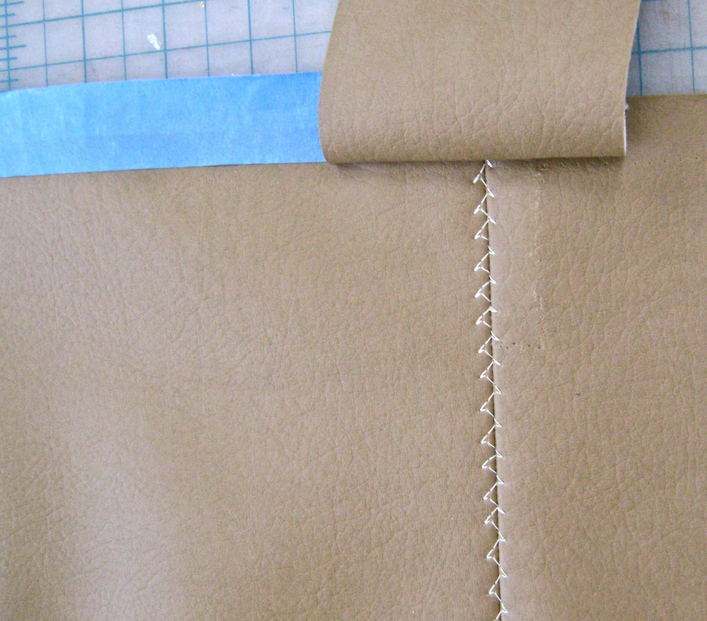 step 11 - Sew side pieces to the bottom seam with right sides together and the center of the strip aligned with the bottom seam.