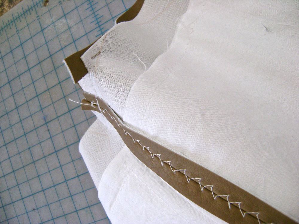 step 13 - Pin and sew the sides pieces to the bag front and back sections creating a flat bottom for the bag.  Sew the side piece seams all the way up to the top of the bag.