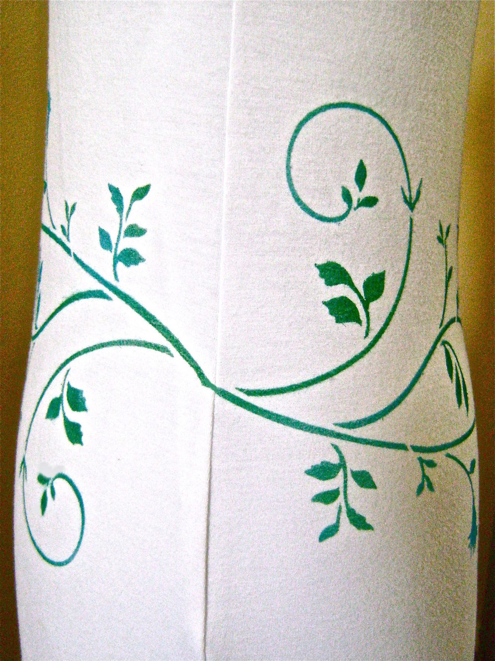 step 3 - Give some thought to how you'll match up the stencil design at the side seams to eliminate a large gap in the design when the front and back pieces are sewn together. You may be able to achieve this by masking portions of the stencil with tape before painting, or by repeating only a portion of the stencil. The horizontal width of your fabric pieces will be a big factor in matching the painted design at the side seams.  Even if a perfect match may not be possible, an acceptable transition should.