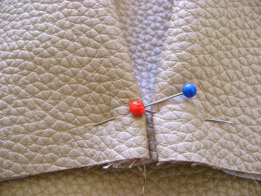 "step 8 - Pin .25"" folds facing the center of pocket at the bottom edge."