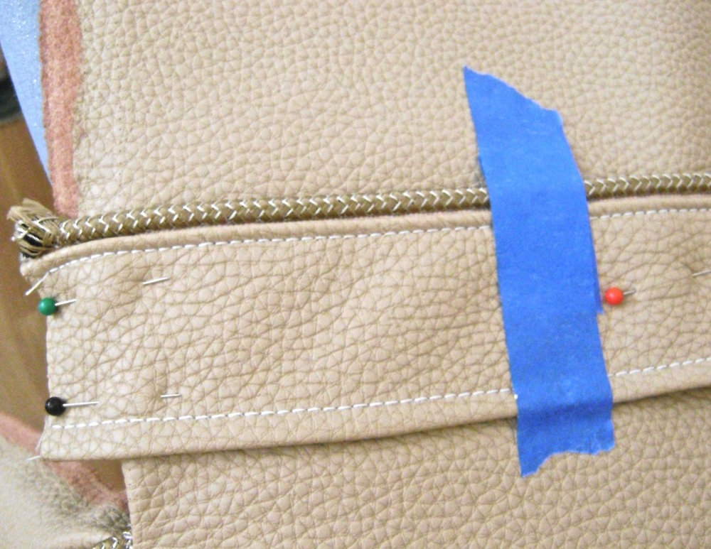 "step 15 - Pin the band to the bag back 3.25 from the top edge. Place tape 4"" in from the sides. Stitch the top and bottom edges of the band up to the tape on each side leaving an 8"" opening in the center."