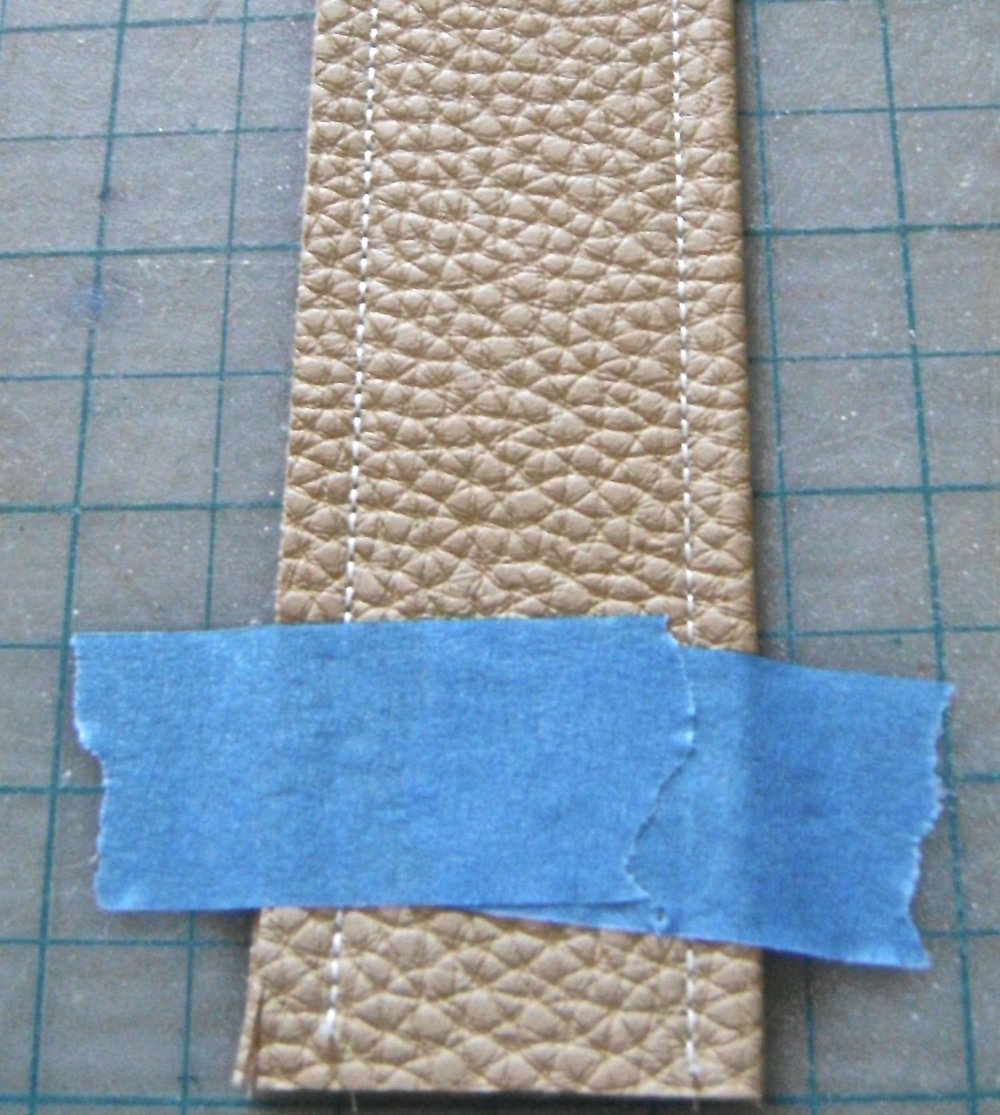 step 18 - Tape each strap to a cutting mat to align it and get an accurate trim of both side edges.