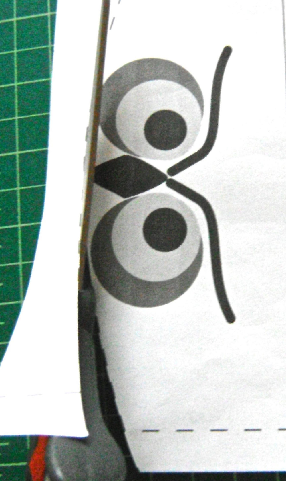 step 9 - Trim the seam allowance from the front flap pattern piece and align the pattern with the fabric edge.