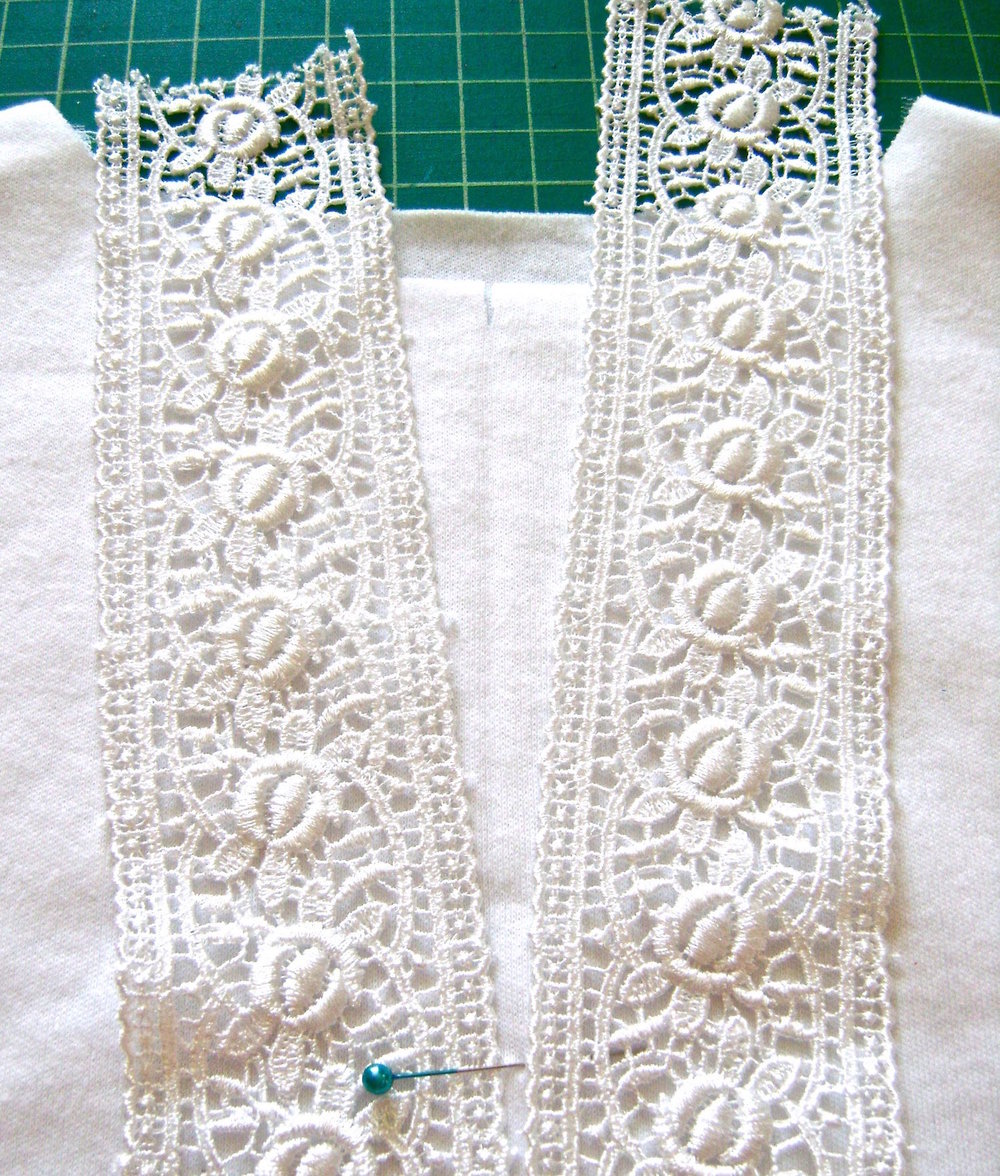 "step 5 - Move the top of the lace strips .75"" away from the center crease but still meeting at the mark for the opening."