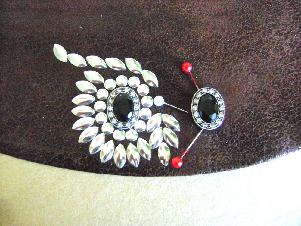 step 14 - Work on the right side eye and eyebrow following the same steps.  Glue the eyes to the fabric and allow to dry.